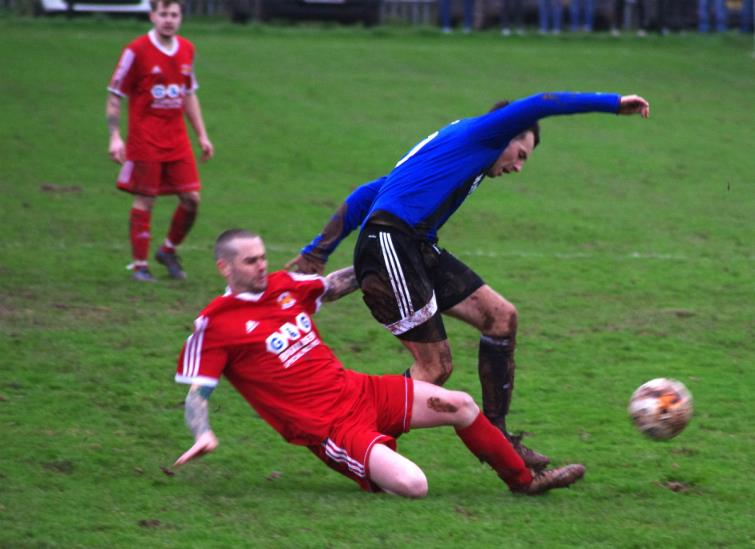 West Dragons player manager Chris Hughes tackles Hakins Ryan Wilson.