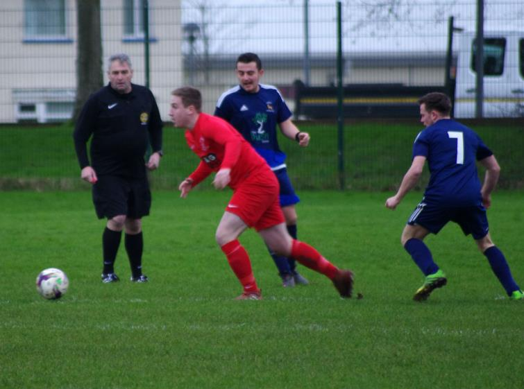 Luke Phillips in possession for Pennar Robins who lost at home against close rivals Lamphey