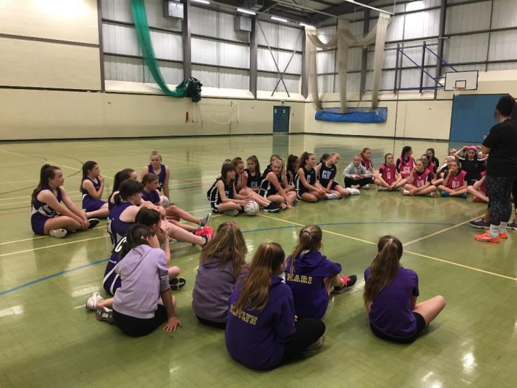 Netball squads receiving their instructions