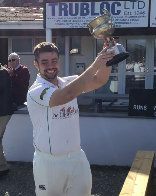 Skipper Richard Reed holds the Alan Brown Cup