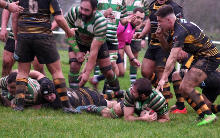 Whitland flanker Ryan Morgan pounces for a try