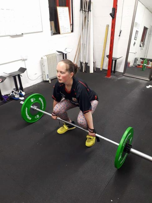Sarah preparing to lift