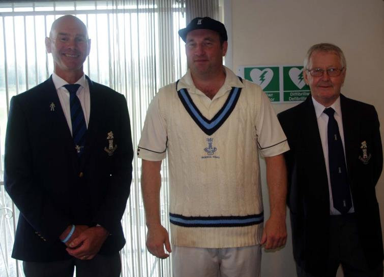 Simon Holliday (centre) awarded a PCCC Cap by officials Paul Webb (left) and Nick Evans (right)