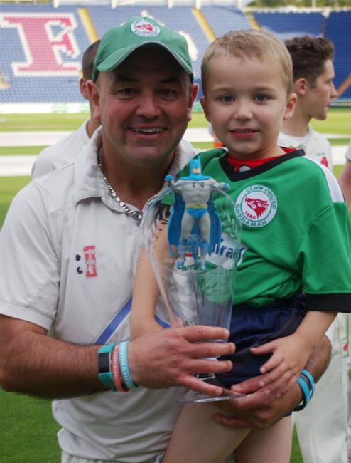 Winning Ammanford captain Alun Evans with his son and glassware trophy