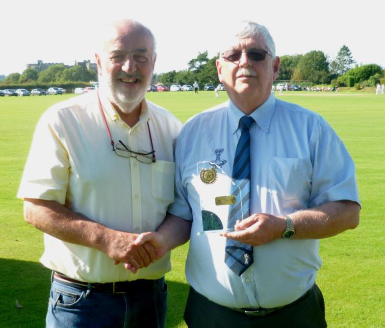 Bill Carnes presents Trefor Evans with the Star of the Month Award for August