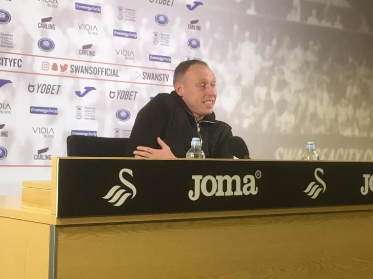 Swansea City manager Steve Cooper talks to the press