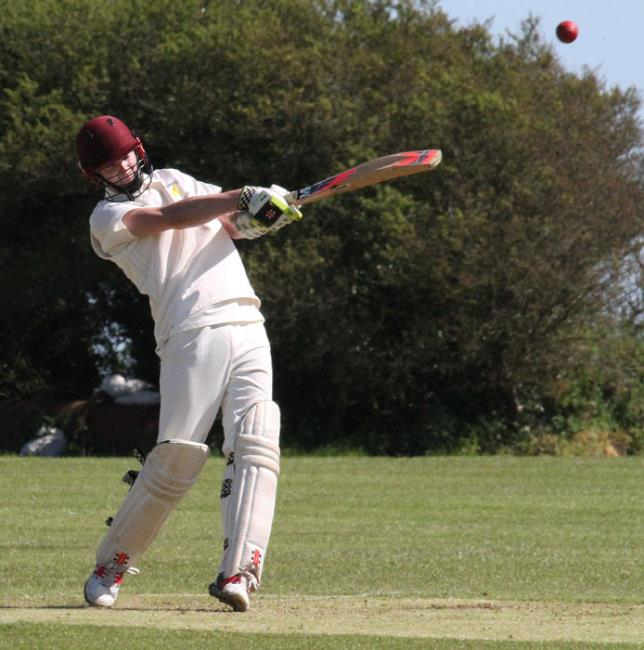 Tom Cole hits another boundary on   his way to a half-century.