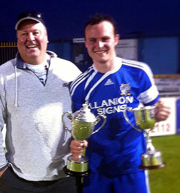 Proud moment - Steve Callan with his son Jamie showing off the silverware