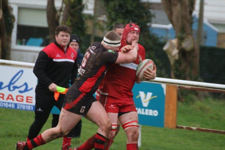 Will Edwards takes a big tackle for Pembroke