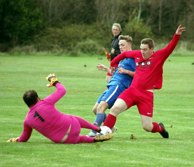 Bridges Will Haworth is denied by some stern defending from Pennar Robins