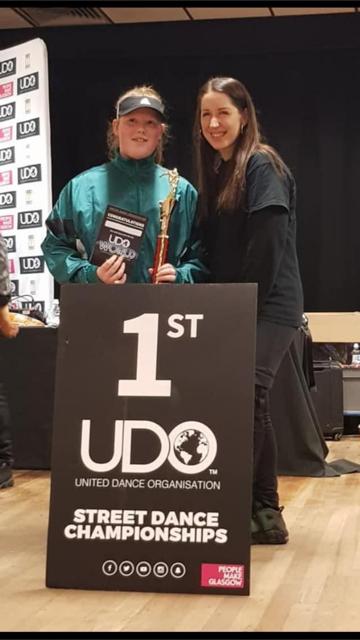 Kelci winning a UDO Street Dance Competition