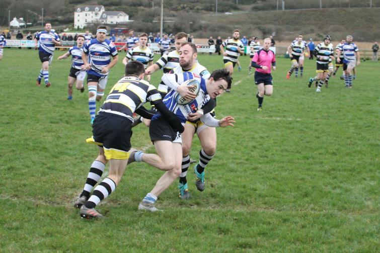 Fishguards Robbie Jones is caught bt Tumbles cover defence.
